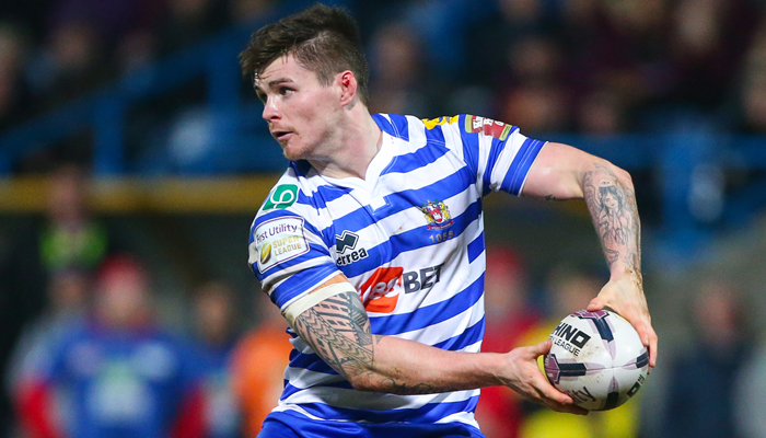 John Bateman playing for Wigan against Huddersfield in Super League.