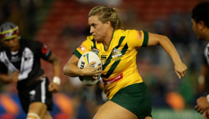Australian Jillaroos player Ruan Sims runs with the ball.