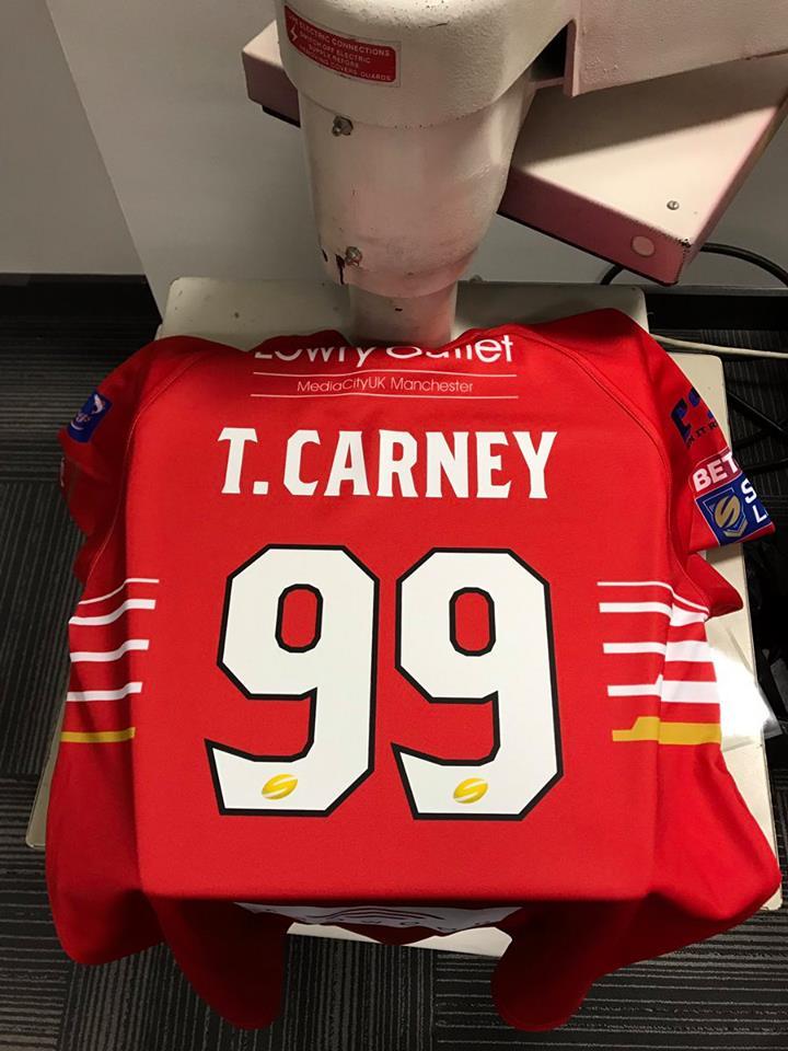 Carney given strange squad number