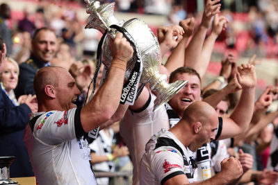 Hull FC captain Gareth Ellis lifts the Ladbrokes Challenge Cup after Hull FC's 12-10 victory over the Warrington Wolves at Wembley Stadium.