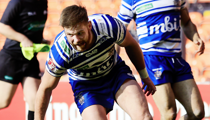 Halifax centre Ste Tyrer touches the ball down for a try.