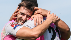 Toulouse players celebrate a try in the Challenge Cup.